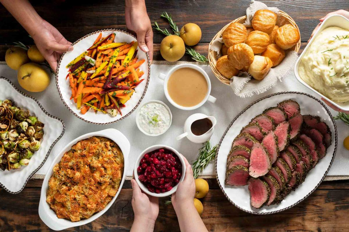 Contemporary Holiday Meal with hands serving