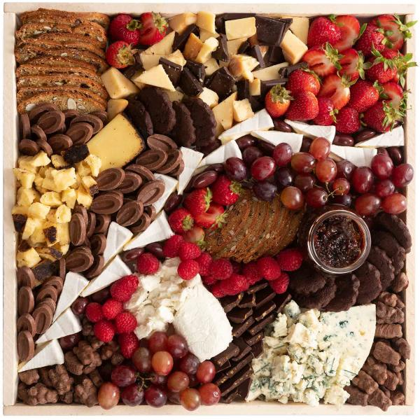 Large Chocolate and Cheese Cheese Board. Candi… Chocolate with cheese.