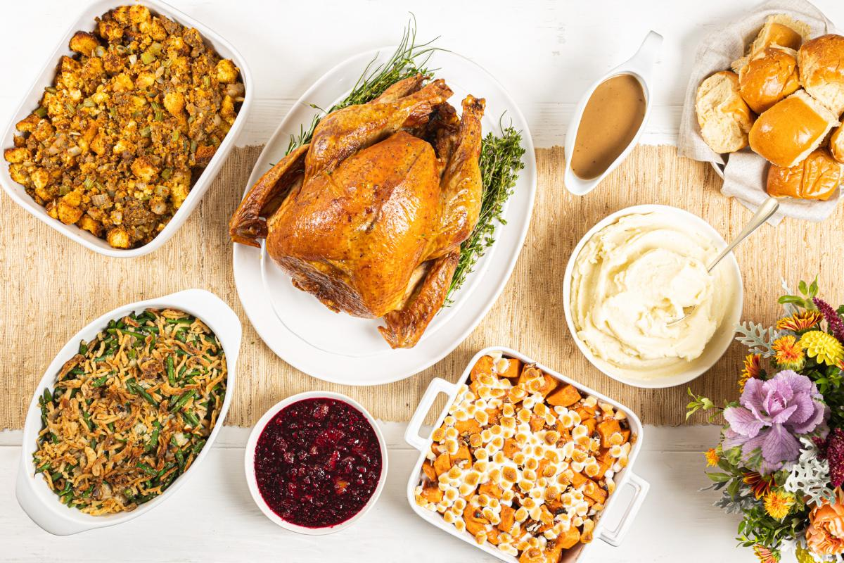Roast turkey, green beans, stuffing, cranberries, mashed potatoes, old fashioned yams and rolls