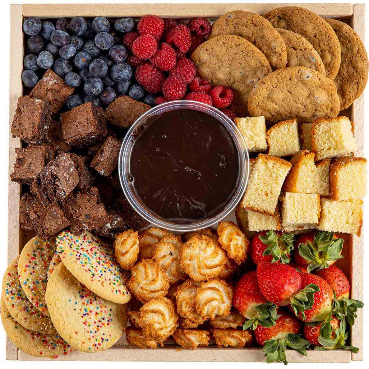 Tray of brownies, cookies, fruit and chocolate fondue