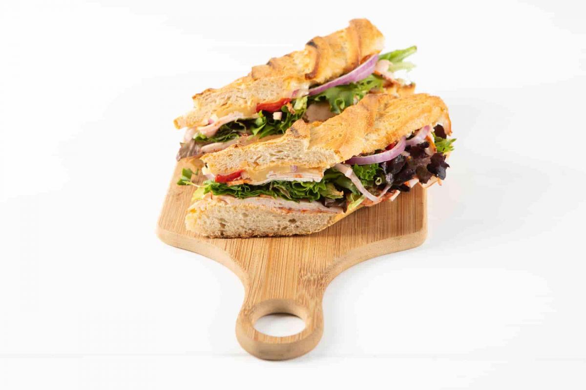 Sliced Firecracker sandwich on wooden cutting board