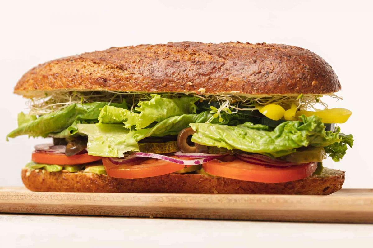Whole Van Gogh sandwich on a wooden cutting board