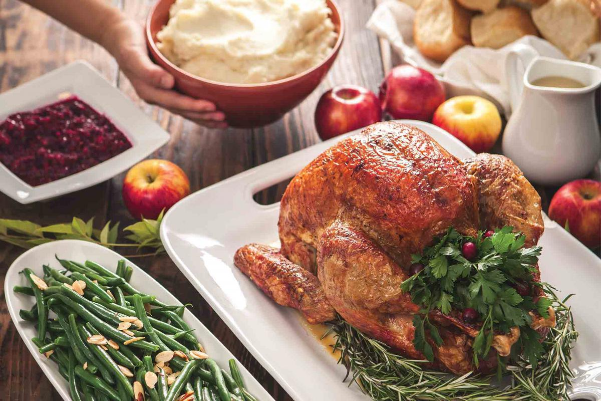 Roast turkey, green beans, cranberries, mashed potatoes and rolls