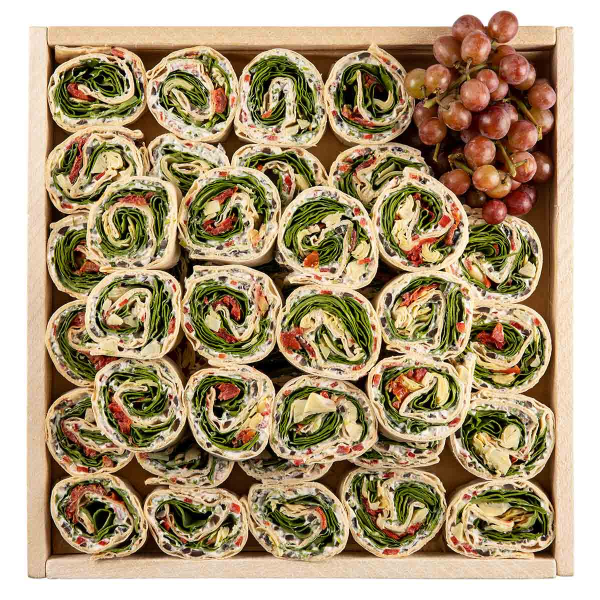 Gourmet aram wraps on a wooden tray