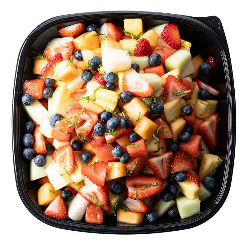 Ginger Lime Fruit Salad in plastic tray